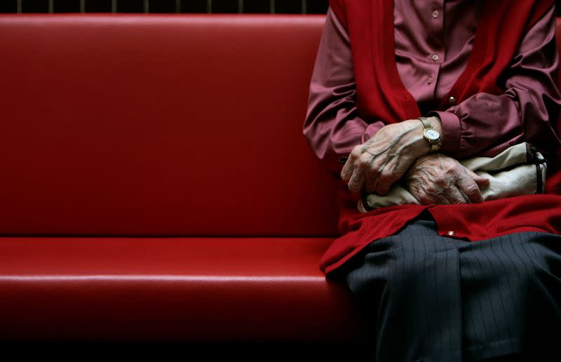 FILE PHOTO: A pensioner sits in a residential home for the elderly in Emmenbruecke