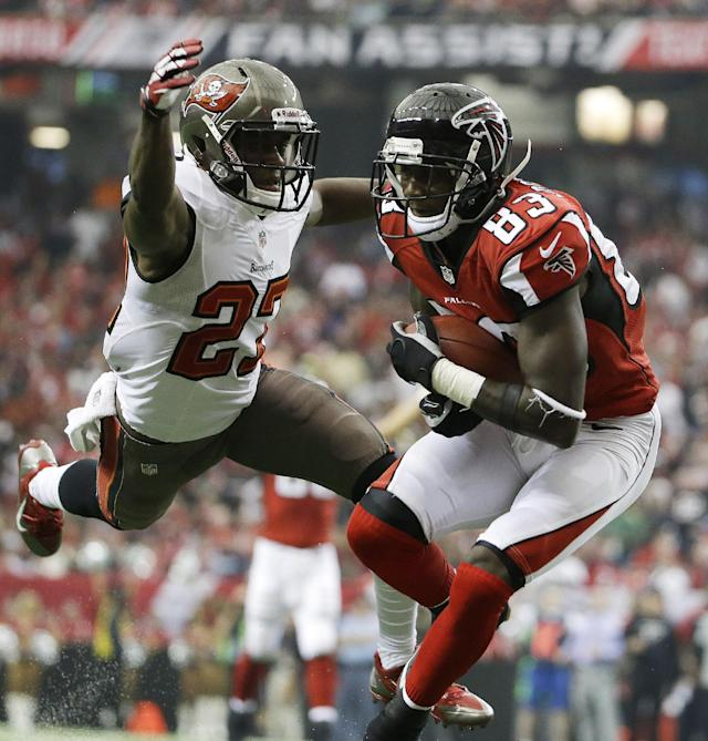 Atlanta Falcons wide receiver Harry Douglas (83) runs into the end zone as Tampa Bay Buccaneers cornerback Johnthan Banks (27) tries to make the tackle during the first half of an NFL football game, Sunday, Oct. 20, 2013, in Atlanta. (AP Photo/David Goldman)