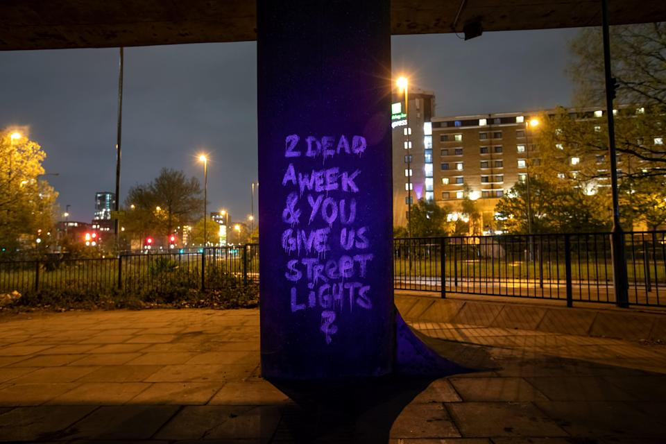 <p>UV messages highlighting violence against women were sprayed on London's streets</p> (George Torode / WEP)