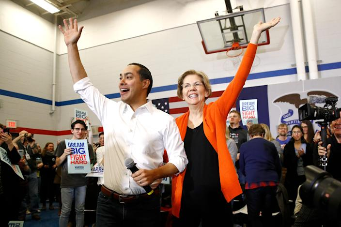 Former Secretary of Housing and Urban Development Julian Castro, left, stands with Democratic presidential candidate Sen. Elizabeth Warren, D-Mass., after introducing her during a campaign event, Sunday, Jan. 12, 2020, in Marshalltown, Iowa.