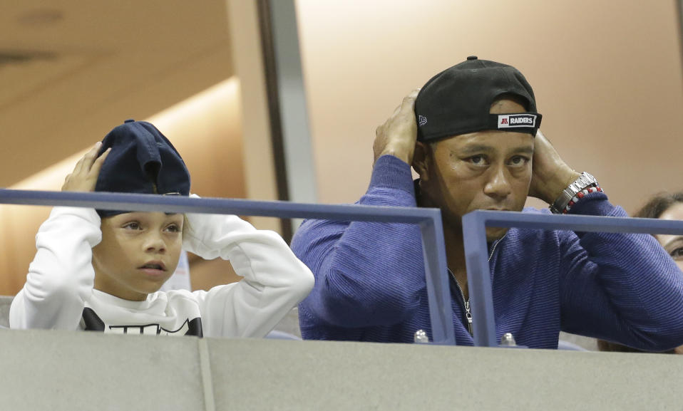 ADDS THE NAME OF TIGER WOODS SON, CHARLIE - Golfer Tiger Woods watches a match between Rafael Nadal, of Spain, and Marin Cilic, of Croatia, with his son, Charlie, during the fourth round of the U.S. Open tennis tournament, Monday, Sept. 2, 2019, in New York. (AP Photo/Seth Wenig)