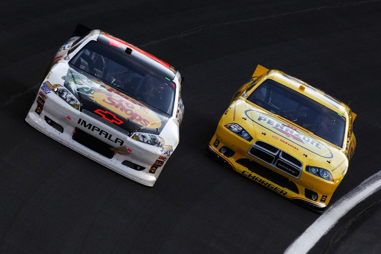 CHARLOTTE, NC - MAY 19:  Jamie McMurray, driver of the #1 Bass Pro Shops/Allstate Chevrolet, and AJ Allmendinger, driver of the #22 Pennzoil Dodge, race during the NASCAR Sprint Showdown at Charlotte Motor Speedway on May 19, 2012 in Charlotte, North Carolina.  (Photo by Jeff Zelevansky/Getty Images for NASCAR)