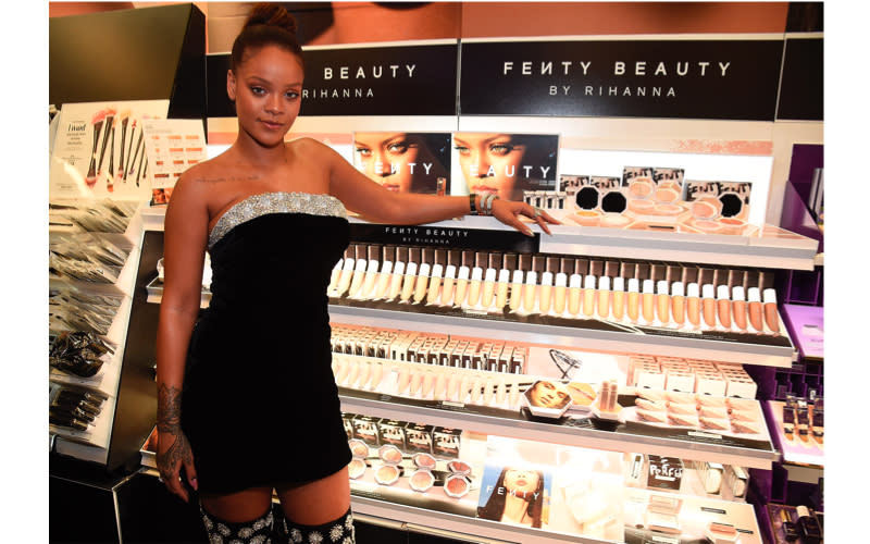 """<p>In September 2017, Rihanna made her foray into the beauty sphere with the highly-anticipated launch of Fenty Beauty. According to <a rel=""""nofollow noopener"""" href=""""https://www.vogue.com/article/rihanna-beauty-secrets-fenty-how-to-tutorial-vogue-cover-june-getting-ready-makeup-face-body"""" target=""""_blank"""" data-ylk=""""slk:Vogue"""" class=""""link rapid-noclick-resp""""><em>Vogue</em></a>, the singer raked in approximately $100 million in the first 40 days thanks to her inclusive 'foundation for all"""" tagline. In a bid to make the beauty industry a more diverse place, the singer's debut line featured a grand total of 40 different hues. In January 2019, she stepped up her game with the launch of 50 different shades of concealer. <em>[Photo: Getty]</em> </p>"""