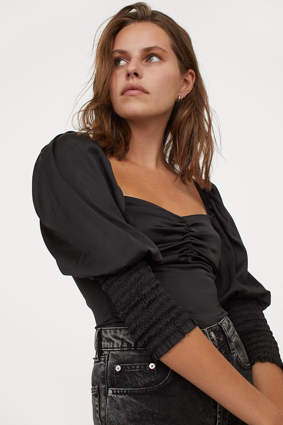 <p>This <span>Puff-sleeved Blouse</span> ($20) will look great with blue jeans and black mules.</p>