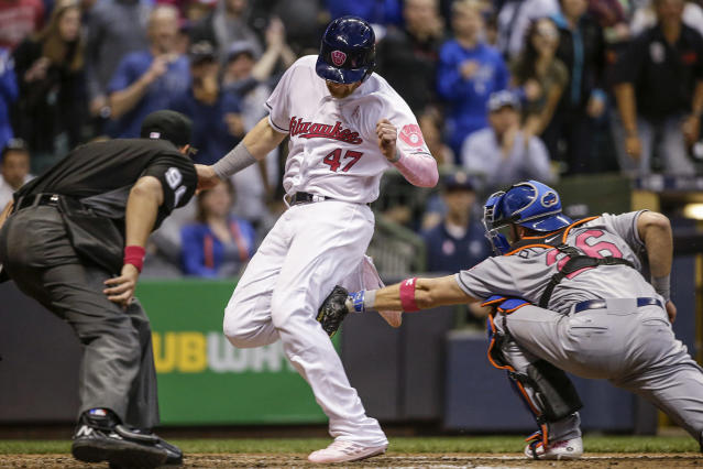 <p>Milwaukee Brewers' Jett Bandy just beats the tag of New York Mets' Kevin Plawecki to score during the fifth inning of a baseball game, May 13, 2017, in Milwaukee. (Photo: Tom Lynn/AP) </p>