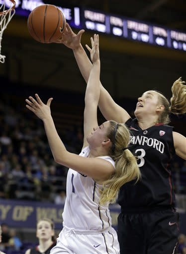 Stanford's Mikaela Ruef (3) tips the ball away on a shot by Washington's Mercedes Wetmore (1) in the first half of an NCAA college basketball game Thursday, Feb. 28, 2013, in Seattle. (AP Photo/Elaine Thompson)