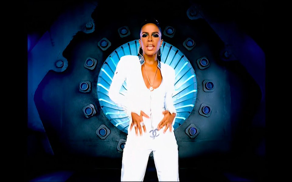 """<cite class=""""credit"""">Screenshot/Youtube. """"More than a Woman"""" music video, Aaliyah.</cite>"""