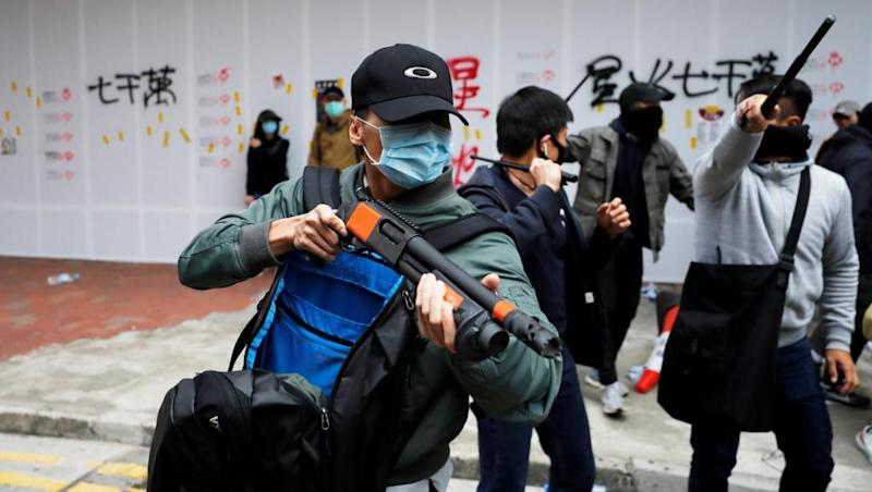 Police officers beaten bloody by Hong Kong protestors