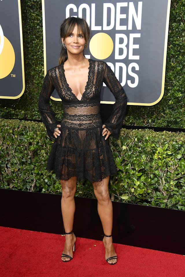 """<p>She isn't afraid to rock a sheer minidress on a red carpet. She rocked this <a href=""""https://www.popsugar.com/celebrity/Halle-Berry-Wearing-Black-Dress-2018-Golden-Globes-44481014"""" class=""""ga-track"""" data-ga-category=""""Related"""" data-ga-label=""""https://www.popsugar.com/celebrity/Halle-Berry-Wearing-Black-Dress-2018-Golden-Globes-44481014"""" data-ga-action=""""In-Line Links"""">lacy bell-sleeved cocktail dress from Zuhair Murad</a> at the 2018 Golden Globe Awards.</p>"""