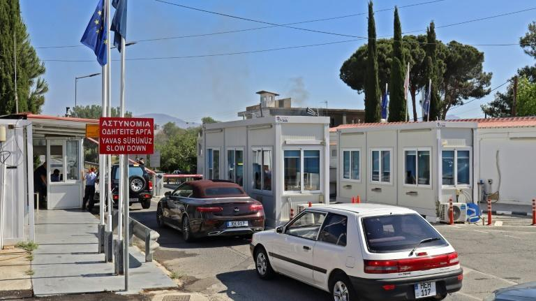 Vehicles pass through the Agios Dometios/Metehan crossing in the Cypriot capital Nicosia heading towards the breakway Turkish Cypriot north