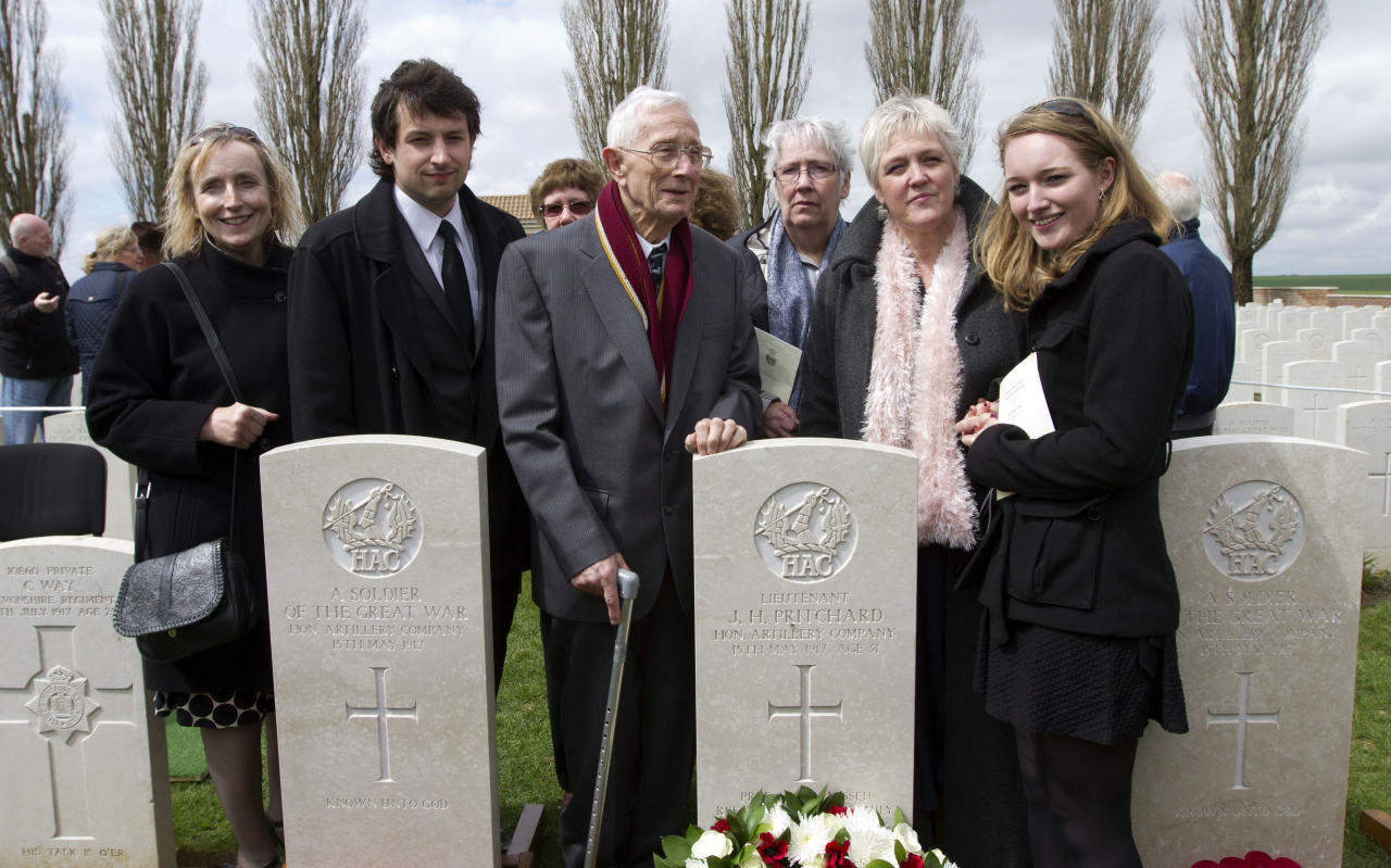 Relatives of British World War One solider Lieutenant John Harold Pritchard are seen in front of the soldiers headstone after a ceremony at the H.A.C. cemetery in Ecoust-St-Mein, France on Tuesday, April 23, 2013. Almost 100 years after they were killed in action, Lieutenant John Harold Pritchard and Private Christopher Douglas Elphick were re-interred with full military honors in a private ceremony. Lieutenant Pritchard was killed in action on May 15, 1917 during an enemy attack near Bullecourt, France and his remains were found in a field near the site in 2009. His body was eventually identified by a silver bracelet with his name engraved on it. Private Elphick was born in Dulwich, South London in 1889. He was killed in action on May 15, 1917 during an enemy attack near Bullecourt, France and his remains were found in a field near the site in 2009. His body was eventually identified by a signet ring bearing his initials. (AP Photo/Virginia Mayo)