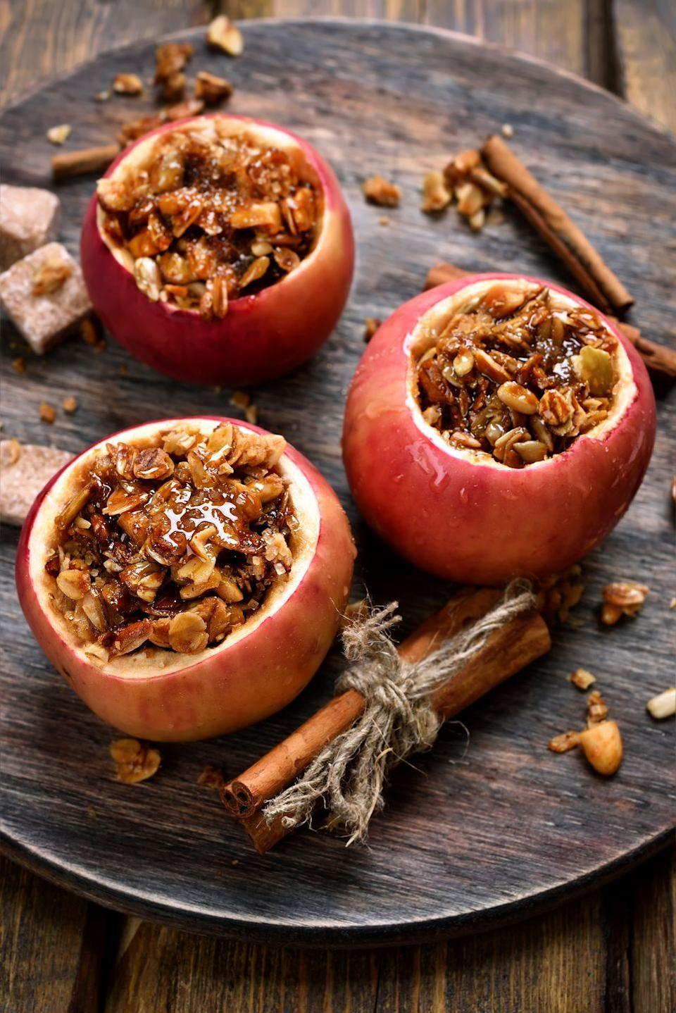 "<p>A perennial crowd-pleaser, aromatic baked apples, stuffed with spices and a cranberry granola filling, can be prepared in advance and then baked as your family enjoys dinner.</p><p><strong><a href=""https://www.countryliving.com/food-drinks/recipes/a1300/cranberry-granola-spiced-apples-3414/"" rel=""nofollow noopener"" target=""_blank"" data-ylk=""slk:Get the recipe"" class=""link rapid-noclick-resp"">Get the recipe</a>.</strong></p>"