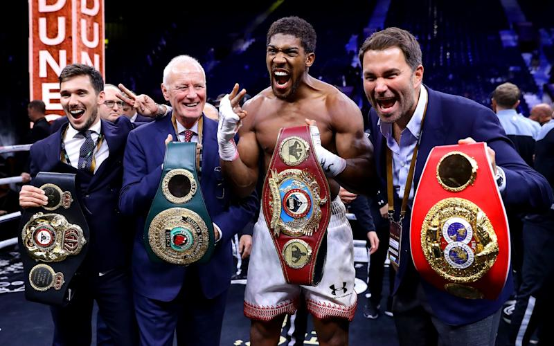 Anthony Joshua poses for a photo with the IBF, WBA, WBO & IBO World Heavyweight Title belts with Eddie Hearn and Barry Hearn after the IBF, WBA, WBO & IBO World Heavyweight Title Fight between Andy Ruiz Jr and Anthony Joshua during the Matchroom Boxing 'Clash on the Dunes' show at the Diriyah Season on December 07, - Richard Heathcote/Getty Images Sport