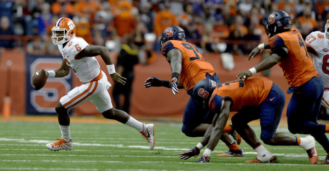 "Clemson quarterback <a class=""link rapid-noclick-resp"" href=""/ncaaf/players/264387/"" data-ylk=""slk:Zerrick Cooper"">Zerrick Cooper</a> (6) scrambles out of the pocket during the second half of an NCAA college football game against Syracuse, Friday, Oct. 13, 2017, in Syracuse, N.Y. Syracuse upset Clemson 27-24. (AP Photo/Adrian Kraus)"