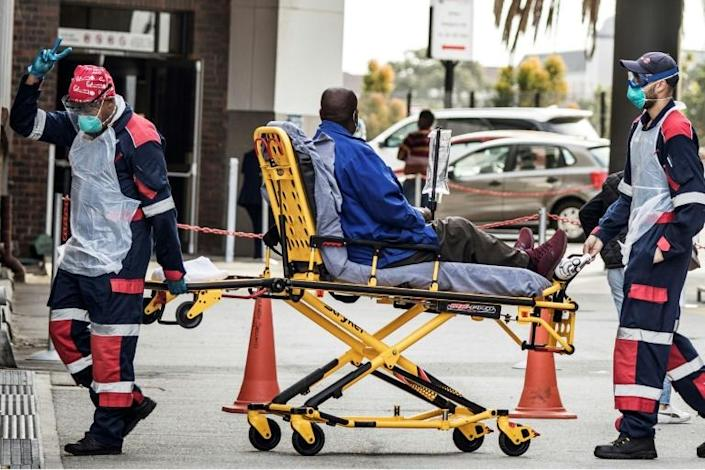 Emergency: Paramedics in Port Elizabeth bring a patient to the city's Greenacres Hospital (AFP Photo/MARCO LONGARI)