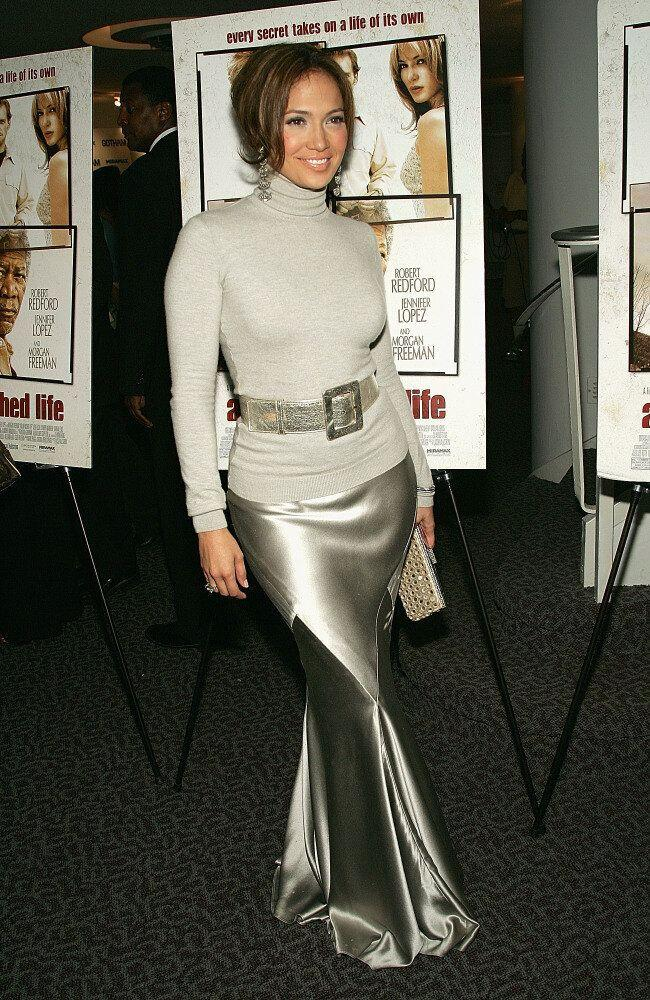 Actress Jennifer Lopez wears a grey jumper with silver fishtail skirt and matching belt for her film premiere.