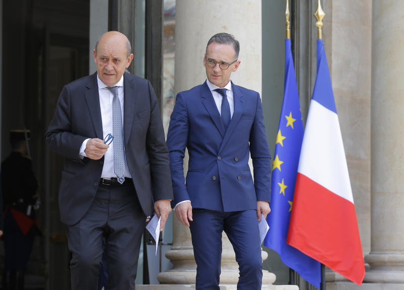 French Foreign Minister Jean-Yves Le Drian, left, and his German counterpart Heiko Maas arrives for a media conference after the cabinet meeting at the Elysee Palace in Paris, France, Wednesday, June 19, 2019. German Foreign Minister Heiko Maas says the risk of war in the Gulf is not ruled out amid rising tensions between Iran and the United States.(AP Photo/Michel Euler)