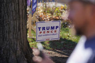 A President Donald Trump sign is posted in the front yard of Craig Rudisel as he speaks about Vigo County voting, Wednesday, Nov. 11, 2020, in Terre Haute, Ind. Rudisel supports Trump's position on guns, abortion and taxes. (AP Photo/Darron Cummings)
