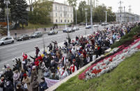 People, most of them elderly women, walk during an opposition rally in Minsk, Belarus, Monday, Oct. 19, 2020. The elderly rallied in Minsk once again on Monday to demand resignation of the country's President Alexander Lukashenko, as mass protests triggered by a disputed election continue to rock Belarus. Lukashenko's older supporters also gathered in the country's capital Monday for a pro-government rally. (AP Photo)