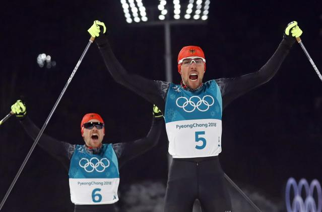 Nordic Combined Events - Pyeongchang 2018 Winter Olympics - Men's Individual 10 km Final - Alpensia Cross-Country Skiing Centre - Pyeongchang, South Korea - February 20, 2018 - Johannes Rydzek of Germany and Fabian Riessle of Germany celebrate as they cross the finish line. REUTERS/Kai Pfaffenbach