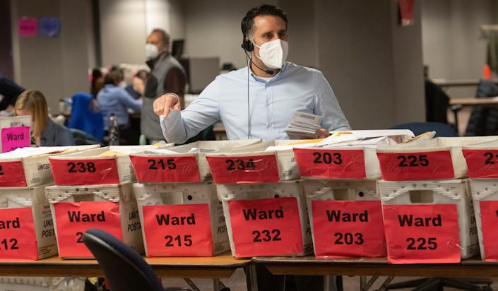 Workers process Election Day ballots at the City of Milwaukee Central Count Facility in Milwaukee.