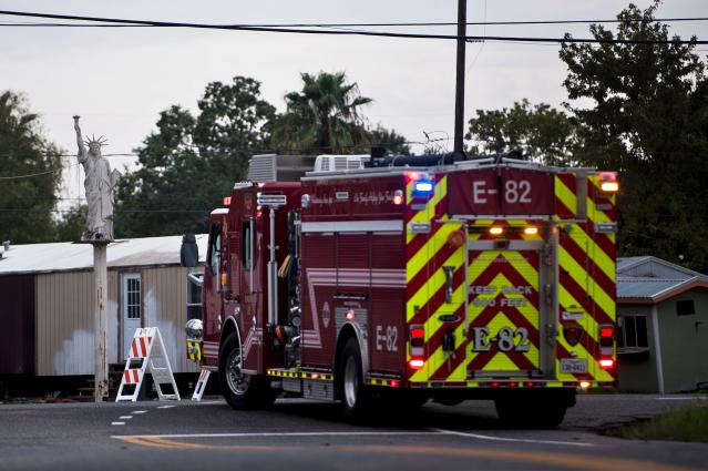 <p>A firetruck waits at a roadblock after a chemical plant operated by the Arkema Group had an explosion during the aftermath of Hurricane Harvey on .Aug. 31, 2017 in Crosby, Texas. (Photo: Brendan Smialowski/AFP/Getty Images) </p>