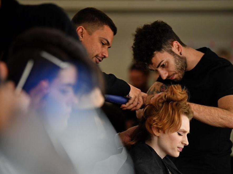 Models have their hair and make-up prepared before presenting creations by fashion house Richard Quinn during the catwalk show for their Autumn/Winter 2020 collection on the second day of London Fashion Week in London (AFP via Getty Images)