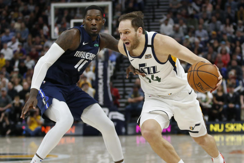 Dallas Mavericks forward Dorian Finney-Smith (10) guards Utah Jazz forward Bojan Bogdanovic (44) in the second half during an NBA basketball game Saturday, Jan. 25, 2020, in Salt lake City. (AP Photo/Rick Bowmer)