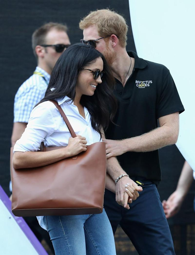 Harry and Meghan held hands on the first day of the Games. Source: Getty