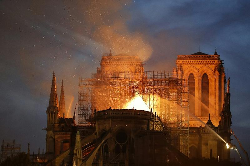 Firefighters try to douse the flames billowing the roof of Notre-Dame, a monument much loved, yet on occasion neglected, according to a top French historian