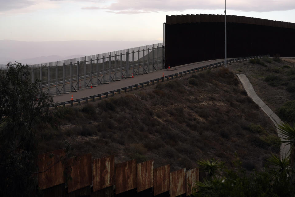 An incomplete secondary wall stands alongside the previous version near where the border separating Tijuana, Mexico, and San Diego meets the Pacific Ocean Tuesday, Jan. 19, 2021, in Tijuana, Mexico. In the days before Joe Biden became president, construction crews worked quickly to finish Donald Trump's wall at an iconic cross-border park overlooking the Pacific Ocean that then-first lady Pat Nixon inaugurated in 1971 as symbol of international friendship. (AP Photo/Gregory Bull)