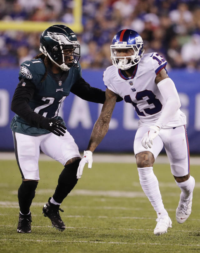Philadelphia Eagles cornerback Ronald Darby (21) covers New York Giants' Odell Beckham (13) during the first half of an NFL football game Thursday, Oct. 11, 2018, in East Rutherford, N.J. (AP Photo/Julio Cortez)