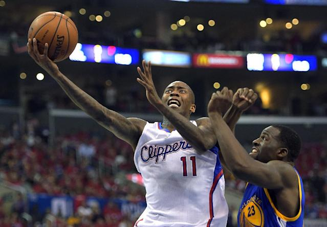 Los Angeles Clippers guard Jamal Crawford, left, goes up for a shot as Golden State Warriors forward Draymond Green defends during the first half in Game 7 of an opening-round NBA basketball playoff series, Saturday, May 3, 2014, in Los Angeles. (AP Photo/Mark J. Terrill)
