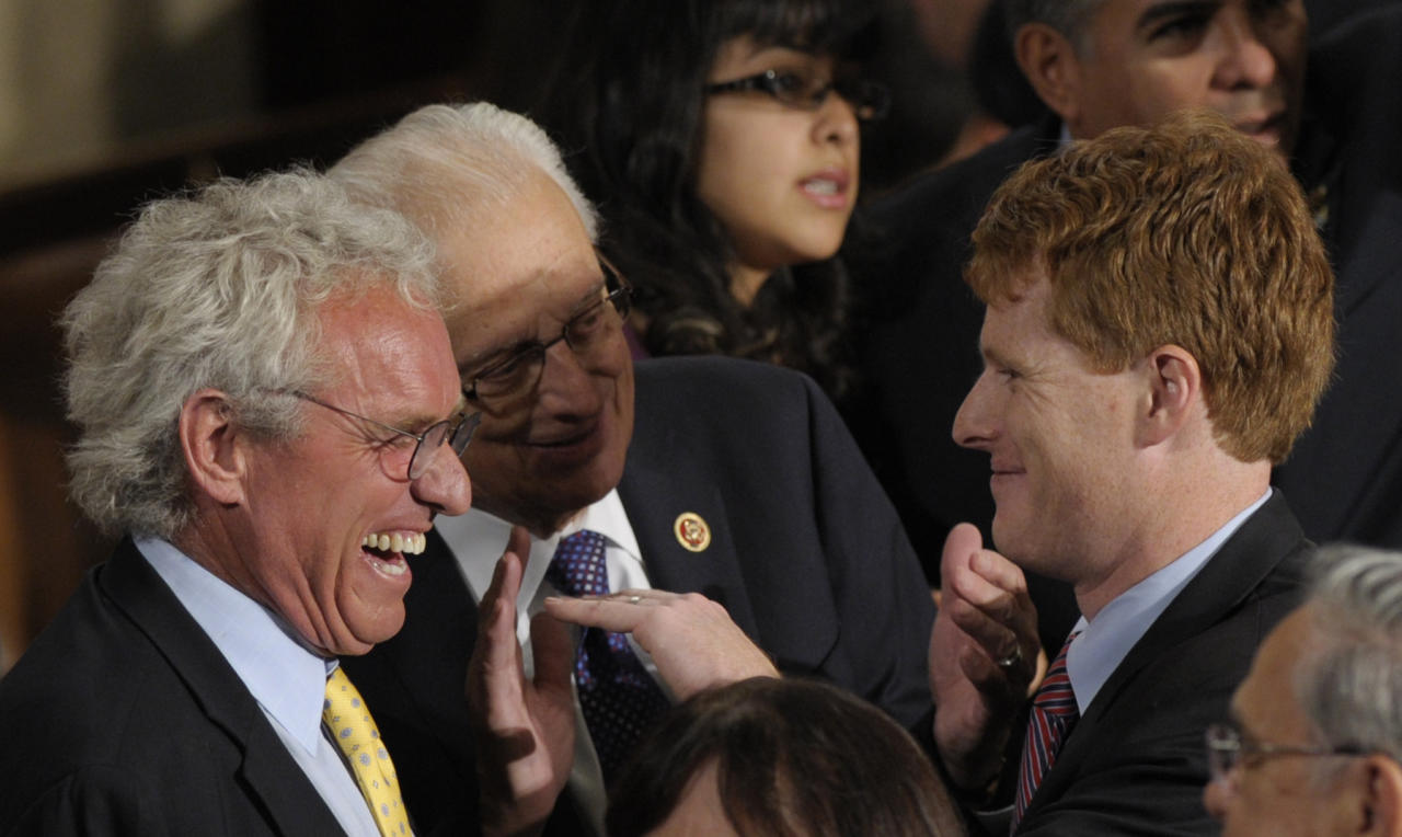 Rep.-elect Joseph P. Kennedy III, D-Mass., grandson of Robert F. Kennedy, right, talks with his father Joseph P. Kennedy II, left, and Rep. Bill Pascrell, Jr., D-N.J., center, as he waits to be sworn in as a member of the 113th Congress, Thursday, Jan. 3, 2013, on Capitol Hill in Washington. (AP Photo/Susan Walsh)