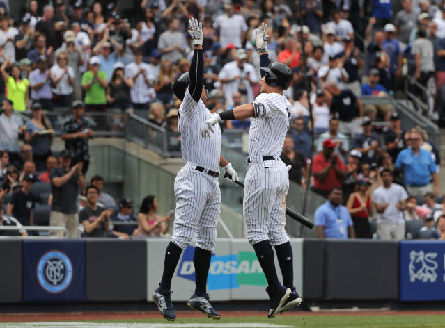 New York Yankees' Aaron Judge, right, celebrates with Giancarlo Stanton after hitting a solo home run against the New York Mets during the seventh inning of a baseball game, Saturday, July 21, 2018, in New York. (AP Photo/Julie Jacobson)