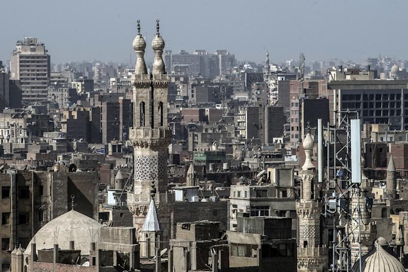 Islamic Cairo is packed with ornate monuments, mosques and mausoleums, and its narrow streets are punctuated with trinket shops, cafes and traditional old homes -- an urban fabric layered in centuries of history (AFP Photo/Khaled DESOUKI)