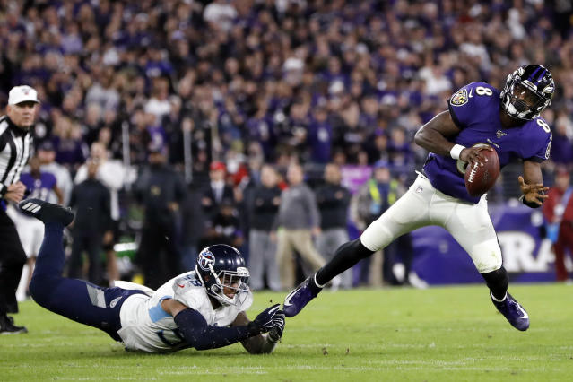 Baltimore Ravens quarterback Lamar Jackson (8) slips away from Tennessee Titans linebacker Harold Landry (58) during the first half an NFL divisional playoff football game, Saturday, Jan. 11, 2020, in Baltimore. (AP Photo/Julio Cortez)