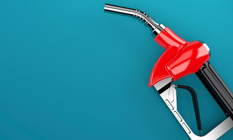 A red fuel pump handle on a blue background.