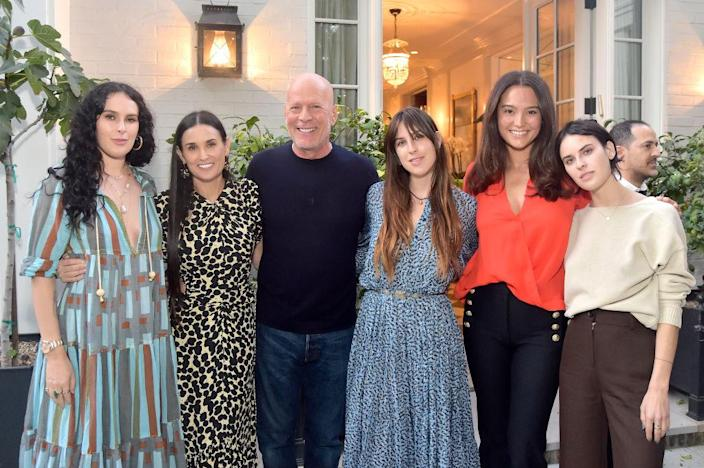 The former couple have remained on good terms, pictured here with their daughters and Bruce's current wife Emma Heming Willis at Demi Moore's <em>Inside Out</em> book party in September 2019. (Getty Images)
