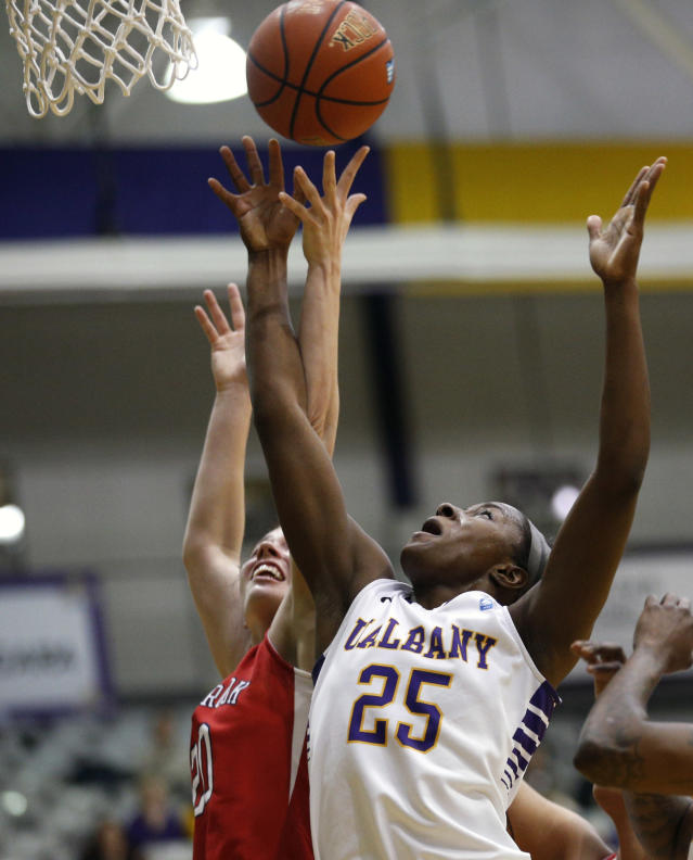 Stony Brook forward Brittany Snow (20) and Albany forward Shereesha Richards (25), of Jamaica, battle for a rebound during the first half of an NCAA America East college championship basketball game on Monday, March 10, 2014, in Albany, N.Y. (AP Photo/Mike Groll)