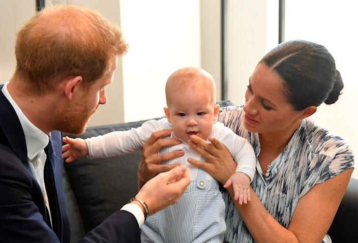 Archie meghan harry in africa