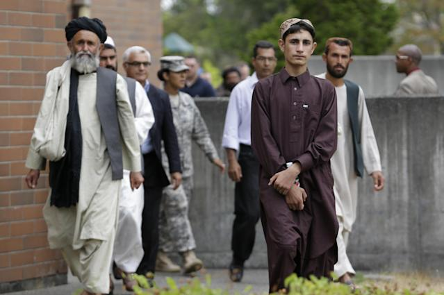 Afghan villagers wait to head to a news conference after a sentencing hearing for Staff Sgt. Robert Bales at Joint Base Lewis-McChord, Wash., on Friday, Aug. 23, 2013. Bales, who massacred 16 Afghan civilians in 2012 in one of the worst atrocities of the Iraq and Afghanistan wars, was sentenced Friday to life in prison with no chance of parole. (AP Photo/Elaine Thompson)