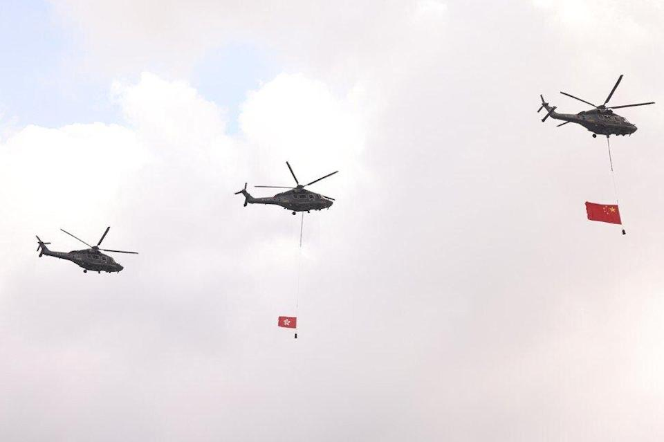 Flag-carrying helicopters fly by the July 1 celebrations in Hong Kong. Photo: K. Y. Cheng