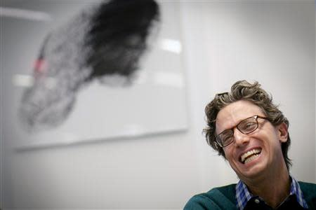 BuzzFeed's Founder and CEO Jonah Peretti reacts during an interview at the company's headquarters in New York January 9, 2014. REUTERS/Brendan McDermid