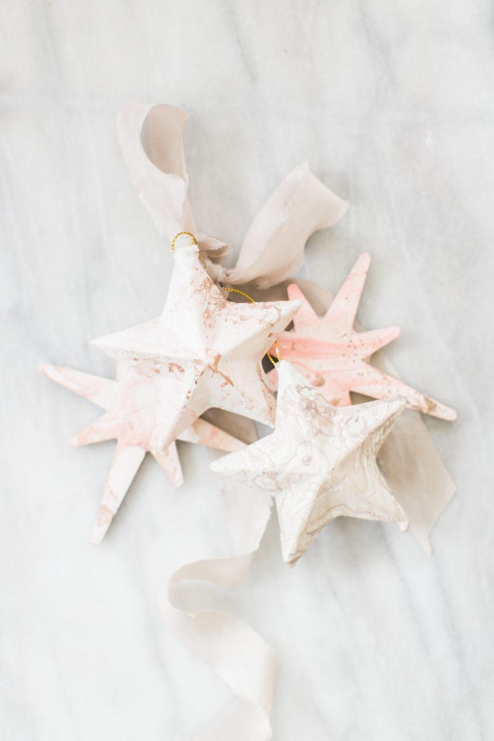 """<p>This DIY ornament gives off major seashell vibes. Bring a piece of the beach right into your home with this easy-to-follow tutorial.</p><p>Get the tutorial at <a href=""""http://www.jacquelynclark.com/2017/12/06/diy-christmas-ornament/"""" rel=""""nofollow noopener"""" target=""""_blank"""" data-ylk=""""slk:Linen & Lark"""" class=""""link rapid-noclick-resp"""">Linen & Lark</a>.</p>"""