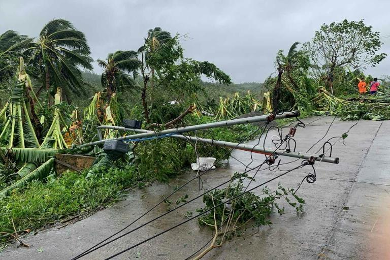 A fallen power line blocks a road after tropical storm Molave hit the town of Pola, Oriental Mindoro province