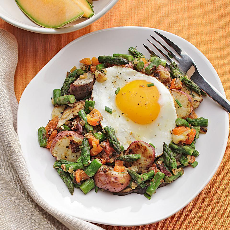 """<p>Made with asparagus, roasted red pepper and mushrooms, this hash has a fresh and light, springtime taste. Serve with hearty whole-grain toast for an easy vegan breakfast or with an egg on top for a vegetarian take. <a href=""""http://www.eatingwell.com/recipe/250430/potato-asparagus-mushroom-hash/"""" rel=""""nofollow noopener"""" target=""""_blank"""" data-ylk=""""slk:View recipe"""" class=""""link rapid-noclick-resp""""> View recipe </a></p>"""