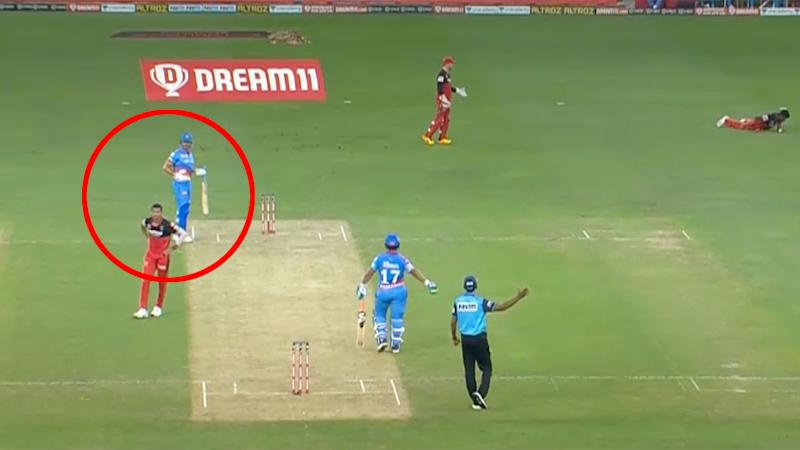 Navdeep Saini can be seen here walking back to the bowling crease after hitting Marcus Stoinis.