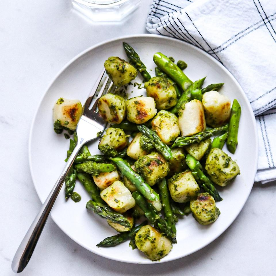 <p>While the cauliflower gnocchi crisp up in a sauté pan, steam fresh asparagus in the microwave to keep it bright green and crisp-tender. Substitute frozen asparagus (or green beans or peas) in a pinch. Toss them together with prepared basil pesto for a satisfying supper.</p>