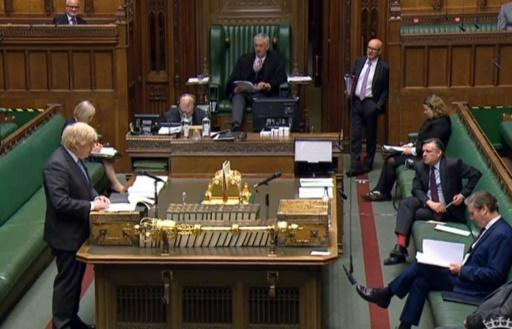 A video grab from footage broadcast by the UK Parliament's Parliamentary Recording Unit (PRU) shows Britain's Prime Minister Boris Johnson giving a statement in the House of Commons in London on the easing of coronavirus restrictions